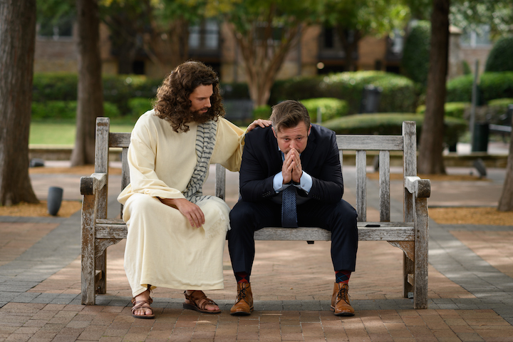 Jesus on Bench with Business Man